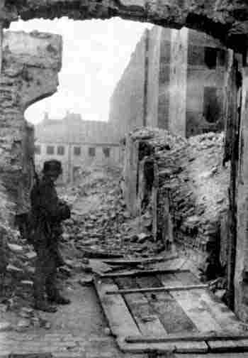 soldier in the ghetto wreckage