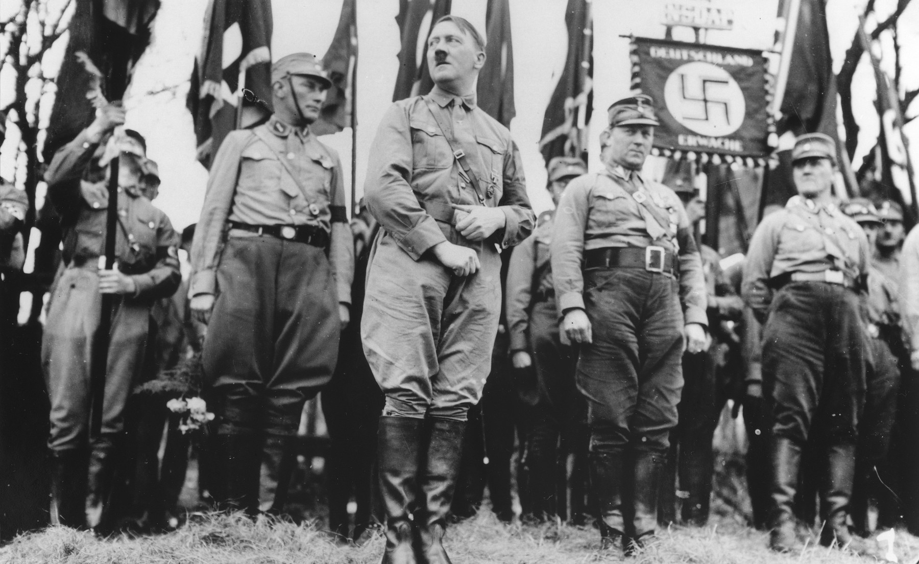 Adolf Hitler stands with an SA unit during a Nazi parade in Weimar